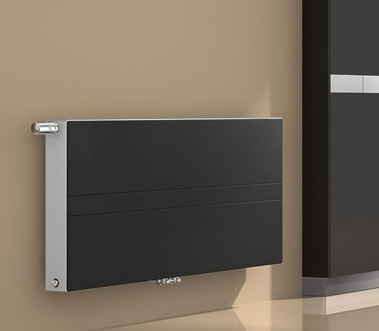 ULOW E2 Low temperature radiator with black panel installed in home